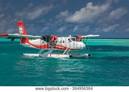 08.09.2019 - Ari Atoll, Maldives: Exotic Scene With Seaplane On Maldives Sea Landing. Seaplane Taxi