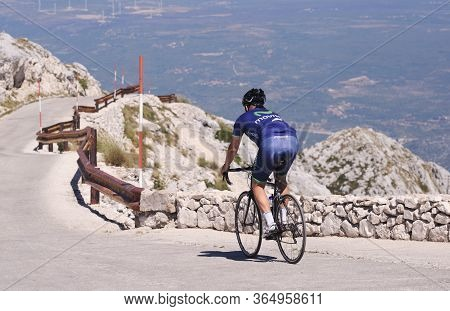 Split, Croatia - July 12, 2019:a Movistar Team Cyclist Cycling Merida Descends From Biokovo Mountain