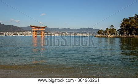 Itsukushima Shinto Shrine In Miyajima Island With Its Floating Red Torii Gate, Unesco World Heritage