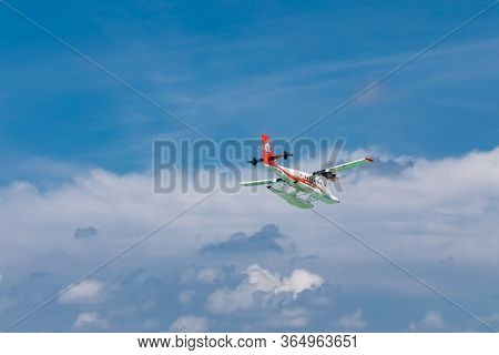 Male, Maldives - November/27/2018: Seaplane Of Trans Maldivian Airways Airline Is Flying In Blue Sky