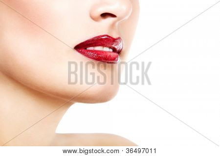 Beautiful lips of young gorgeous fresh woman with vivid red lipstick, face detail. Isolated over white background