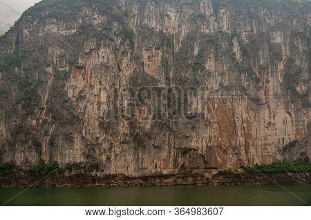 Baidicheng, China - May 7, 2010: Qutang Gorge On Yangtze River. Straigth Down Brown Cliff With Some