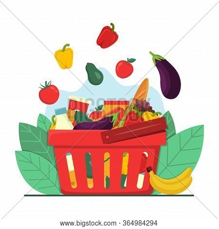 Grocery Shopping Concept. Red Plastic Shopping Basket Full Of Groceries Products. Fruits And Vegetab