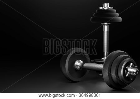 Dumbbell In Dark Background. Closeup And Copy Space On Left. It Is Equipment For Workout Or Fitness