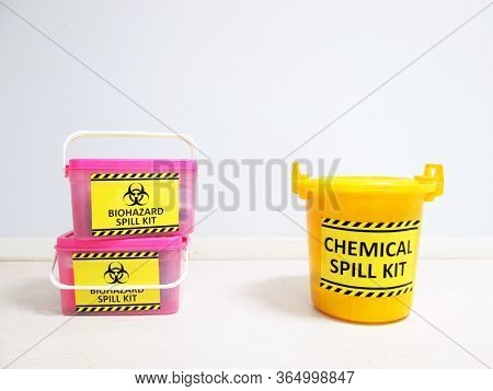 Chemical Spill Kit Yellow Bucket And Biohazard Spill Kit With Warning Danger Caution Biohazard Sign