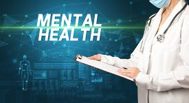 doctor writes notes on the clipboard with MENTAL HEALTH inscription, medical diagnosis concept