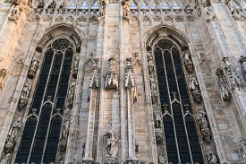 Architecture Detail Of Duomo Di Milano Church In The Morning, Milan Italy.