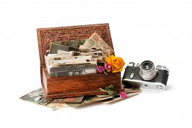 Vintage Film Photo-camera And Old Family Photos Stacked In Wooden Box Isolated On White Background.