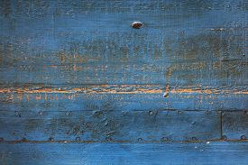Rusty Blue Metal Surface With Nails And Weathered Paint