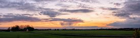 Dramatic Cloudscape Over A Rural Countryside In The Sunset In Panorama View