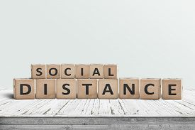 Social Disctance Information Sign Made Of Blocks On A Wooden Table