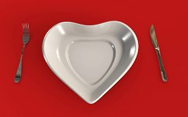 Food Connection To Health Or Love Concept With Heart Shaped Table Plate Isolated With A Fork And A K