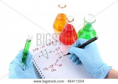 Hand scientist writing formulas isolated on white