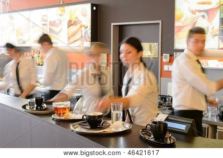 Busy waiter and waitresses working at bar night