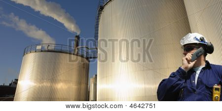 Oil Storage Tanks At Sunset