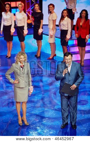 MOSCOW - AUG 3: General director of AHA company, emcee of competition Beauty of Russian Railways Maxim Aksenov and participant at number 11 on stage of central HCR, August 3, 2012, Moscow, Russia.