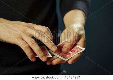 Hands And Playing Cards Trick