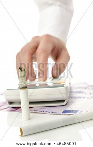 Money being burned away by smoking. Concept of unreasonable money spending for harmful cigarette addiction. poster