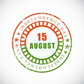 Rubber stamp in national flag colors with text 15 August Independence Day on grey background. poster