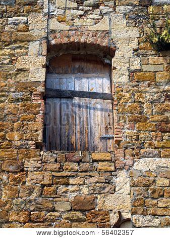 Wooden Window In Stone Wall