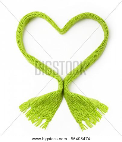 Green wool knitted scarf heart shape on white background.