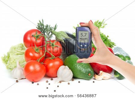 Diabetes Concept Glucose Meter In Hand And Healthy Organic Food Fruits