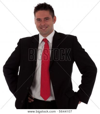 A Confident Young Businessman With His Hands On His Hips