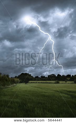 Lightning Strike Over Field Landscape