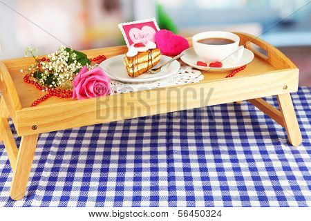 Breakfast in bed on Valentine's Day on room background
