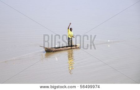 ZAMBIA - MARCH 21: Man fishing on  Luangwa River in the South Luangwa National Park March 21, 2013 in Zambia, Africa