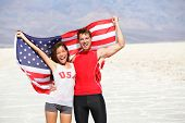 USA athletes people holding american flag cheering. Sports man and fitness runner woman celebrating winning after running. Happy young multicultural fitness couple in excited celebration outside. poster
