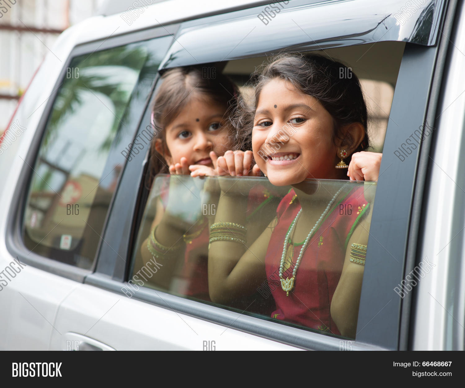 Asian Indian Family Going To A Vacation Happy Children Sitting Inside Car With Window Open