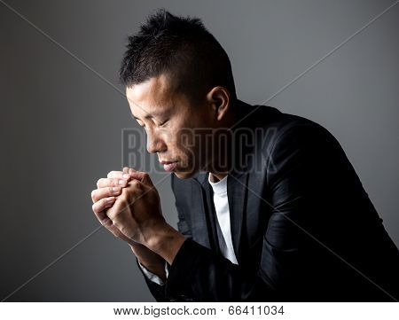 Man pray in darkness