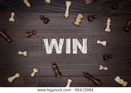 word win on wooden background