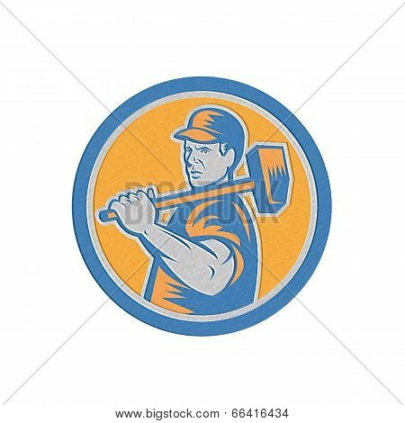 Metallic styled illustration of a union worker holding sledgehammer hammer over shoulder done in retro style set inside circle on isolated background. poster