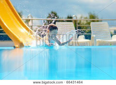 Cute Boy Kid Having Fun On Water Slide