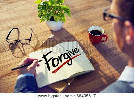 Man with Note Pad and Forgive Concept
