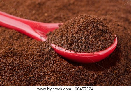 Ground coffee with china spoon