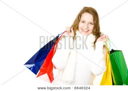 Young Attractive Smiling Woman with shopping bags after Shopping Tour