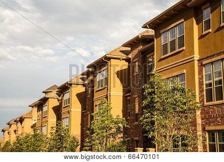 Row Of Brick And Stucco Condos In Morning Light