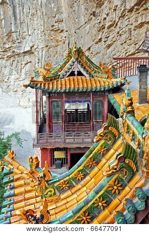 Ornamental beautifully painted roofs of the famous hanging monastery near Datong China viewed from the side poster