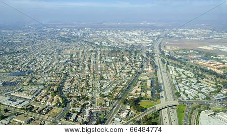 Aerial view of Midway District neighborhood and San Diego International Airport (Lindbergh Field) in Southern California United States of America. Dominated by multi lane roads with heavy traffic poster