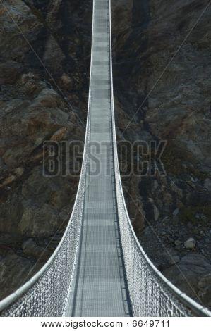 rope bridge in mountains