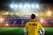 Colombia football player holding ball against stadium full of colombia football fans poster