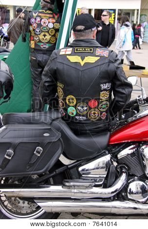 A leather clad biker and his motorcycle