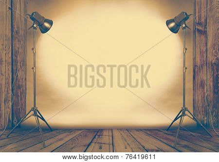 photo studio in old wooden room with concrete wall and paper background , retro filtered, instagram style