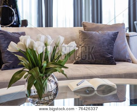 Living Room Sofa With Book And Flower