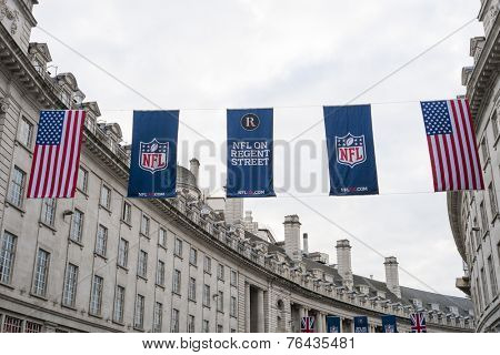 LONDON, UK - SEPTEMBER 27: American flag and NFL banners hanging above in Regent street. September 27, 2014 in London. Regent street was closed to traffic to host NFL related games and events.