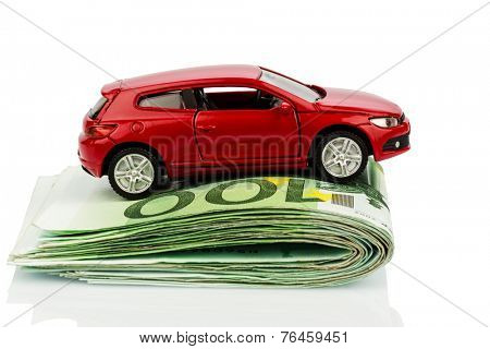 a car standing on euro bills. costs for the purchase of automobiles, gasoline, insurance and other car costs