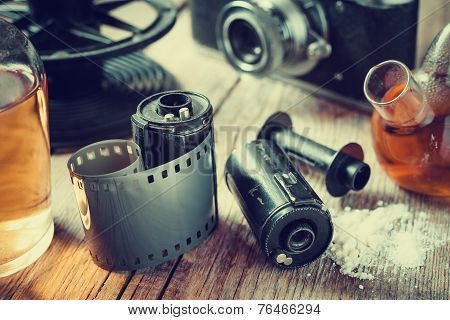 Old Photo Film Rolls, Cassette, Retro Camera And Chemical Reagents For Photographic Film.